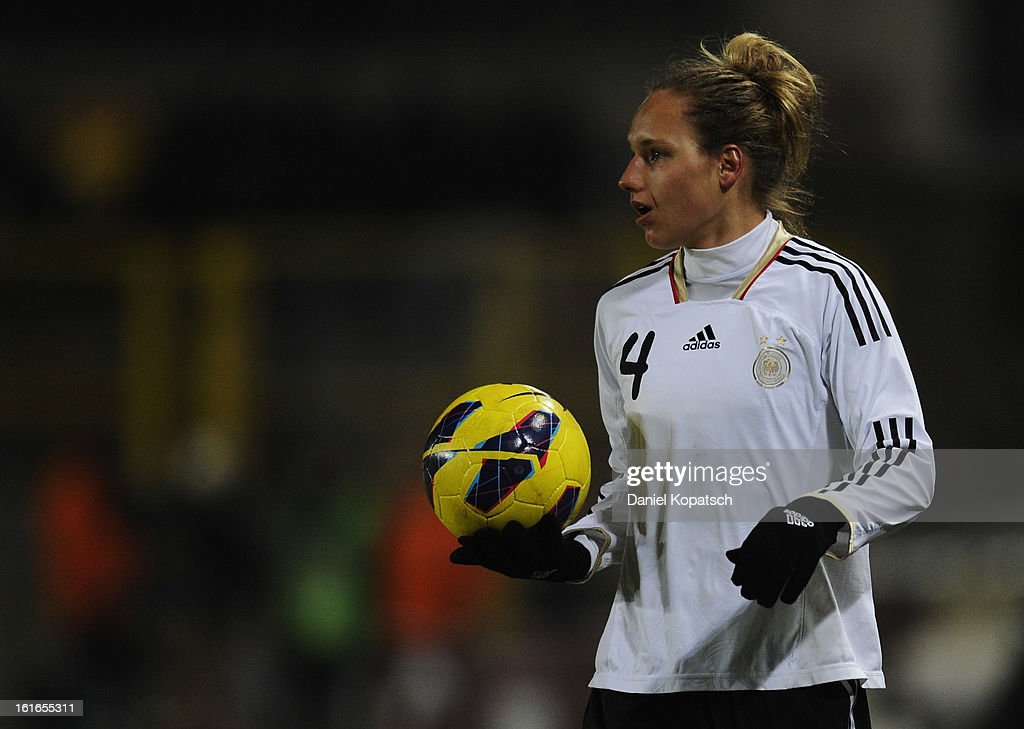 Babett Peter of Germany reacts during the international friendly match between France and Germany at Stade de la Meinau on February 13, 2013 in Strasbourg, France.