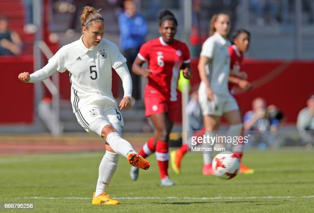 Babett Peter of Germany runs with the ball during the women's international friendly match between Germany and Canada at Steigerwald Stadion on April...