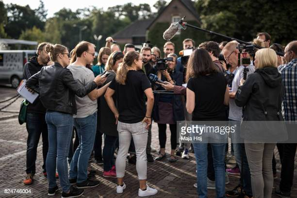 'SHERTOGENBOSCH NETHERLANDS JULY 31 Babett Peter of Germany talks to the press prior team departure in front of the team base hotel on July 31 2017...