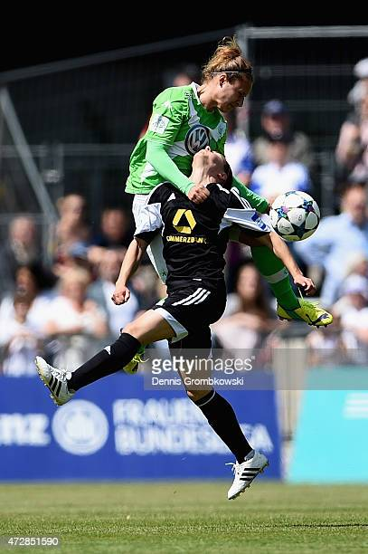 Babett Peter of VfL Wolfsburg and Celia Sasic of 1 FFC Frankfurt go up for a header during the Allianz FrauenBundesliga match between 1 FFC Frankfurt...
