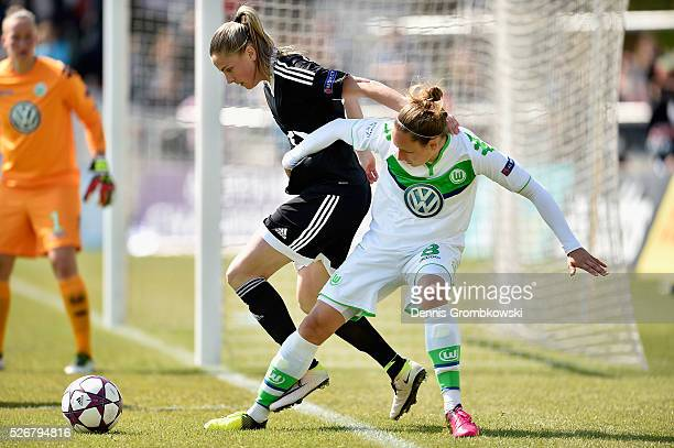 Babett Peter of VfL Wolfsburg challenges AnaMaria Crnogorcevic of 1 FFC Frankfurt during the UEFA Women's Champions League Semi Final second leg...