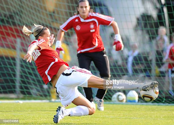 Babett Peter tries to score past goalkeeper Nadine Angerer during the Germany's Women's training session on September 11 2010 in Dresden Germany