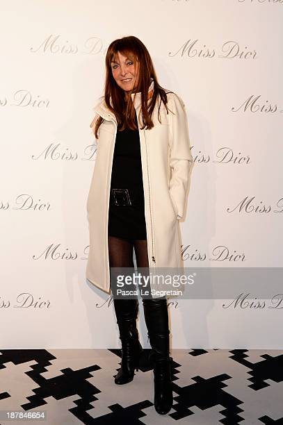 Babette Djian attends a photocall for 'Esprit Dior Miss Dior' exhibtion opening at Grand Palais on November 12 2013 in Paris France