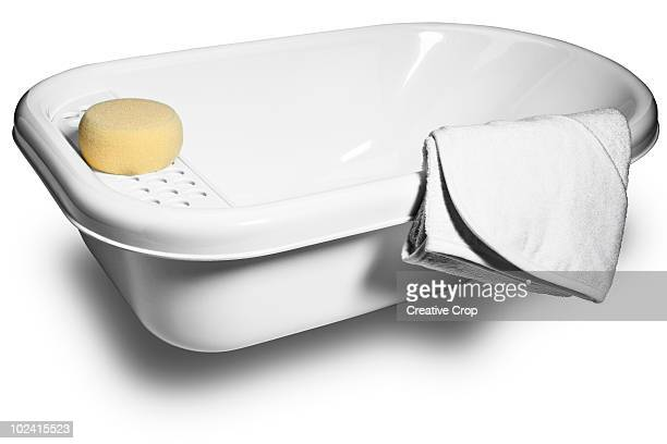 Babies bath, sponge, and towel