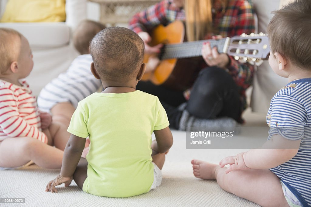 Babies enjoying music class