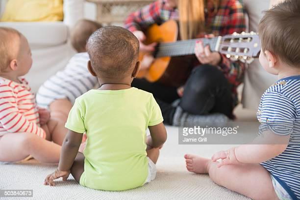 Babies enjoying music class
