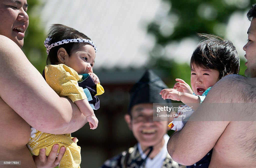 Babies, held by sumo wrestlers, cry during the Nakizumo or crying baby sumo contest at Sensoji Temple on April 29, 2016 in Tokyo, Japan. Babies compete crying at this traditional festival which is believed to bring growth and good health to the infants.