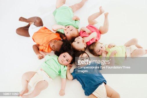 Babies laying on floor