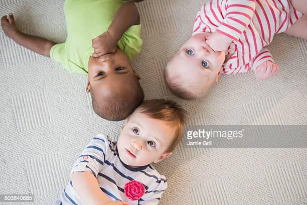Babies lying on floor