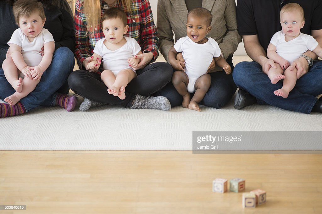 Babies on parents laps