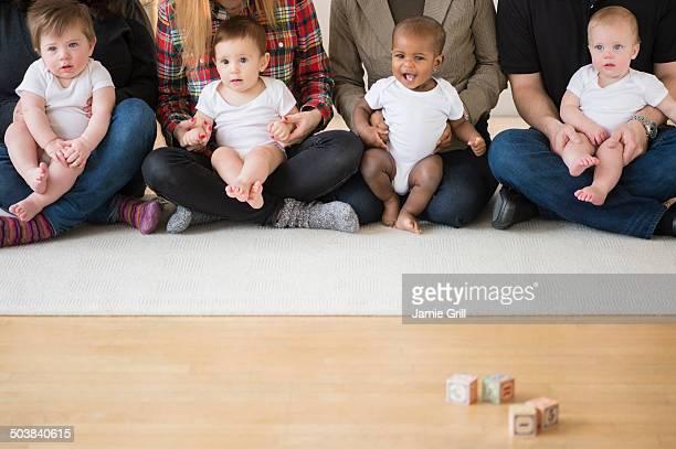 Babies on parents laps