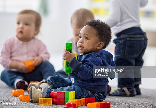 Babies playing together in preschool.