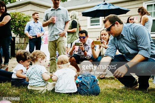 Babies sitting together having picture taken