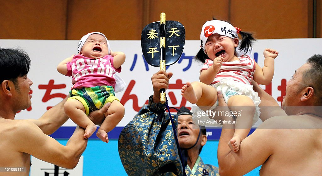 Babies under the age of one lifted by pretended Sumo wrestlers with a call out, in Naki Sumo match, baby cry contest on September 2, 2012 in Shimanto, Kochi, Japan.