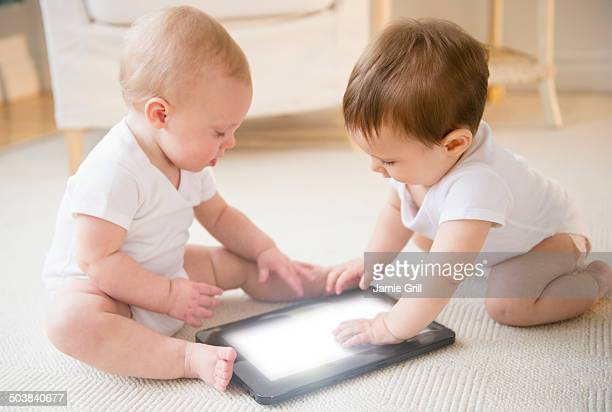 Babies using digital tablet