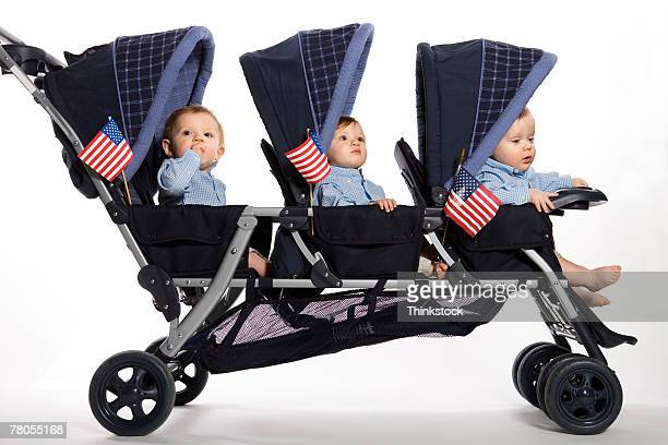 Babies with American flags in stroller
