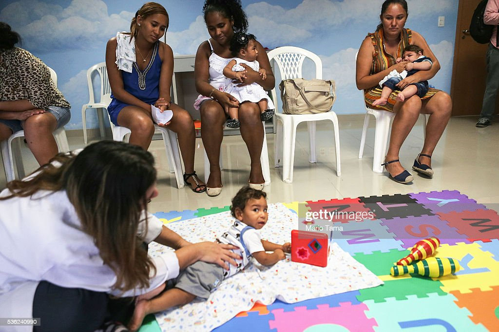 Babies with microcephaly attend a physical therapy session at a clinic on May 31, 2016 in Recife, Brazil. Microcephaly is a birth defect linked to the Zika virus where infants are born with abnormally small heads. The city of Recife and surrounding Pernambuco state remain the epicenter of the Zika virus outbreak, which has now spread to many countries in the Americas. A group of health experts recently called for the Rio 2016 Olympic Games to be postponed or cancelled due to the Zika threat but the WHO (World Health Organization) rejected the proposal. The Olympic torch passed through Recife today.