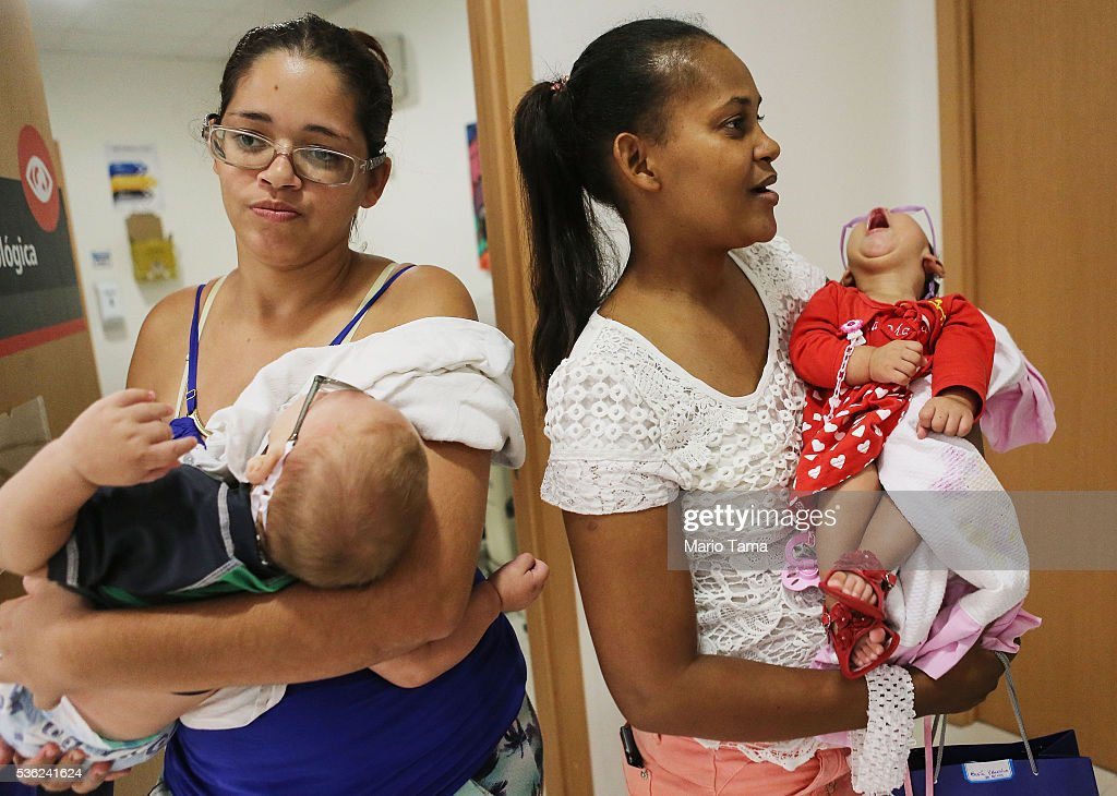Babies with microcephaly David Henrique Ferreira (L) and Sofia Valentine (R) wear their new glasses with their mothers Mylene (L) and Vera after testing in a clinic on May 31, 2016 in Recife, Brazil. Microcephaly is a birth defect linked to the Zika virus where infants are born with abnormally small heads. Vision problems have been reported in some of the infants as well. The city of Recife and surrounding Pernambuco state remain the epicenter of the Zika virus outbreak, which has now spread to many countries in the Americas. A group of health experts recently called for the Rio 2016 Olympic Games to be postponed or cancelled due to the Zika threat but the WHO (World Health Organization) rejected the proposal. The Olympic torch passed through Recife today.