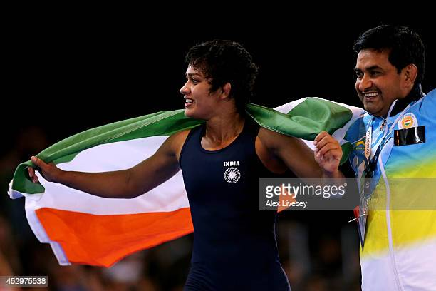 Babita Kumari of India celebrates winning the gold medal in the Women's FS 55kg at Scottish Exhibition and Conference Centre during day eight of the...