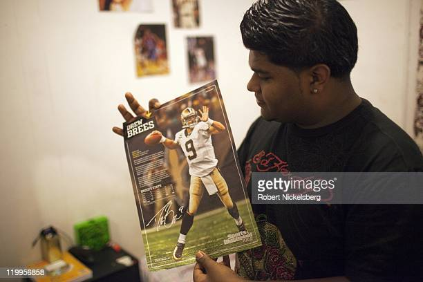 Bablu Sheikh shows one of his favorite football stars February 25 2011 at his house in the Queens borough of New York Bablu a BangladeshiAmerican...