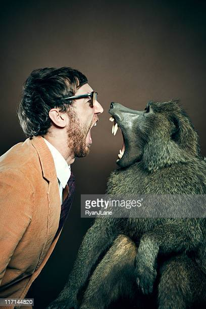 Baboon and Man in Yelling Match
