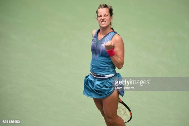 Babora Strycova of Czech Republic reacts after winning the first set in her quarter final match against Anastasia Pavlyuchenkova of Russia during day...