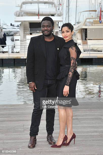 Babou Ceesay and Freida Pinto attend the Guerilla photocall during MIPCOM 2016 at Palais des Festivals on October 17 2016 in Cannes France