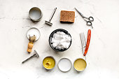 babrer workplace with tools for shaving on white table background top view