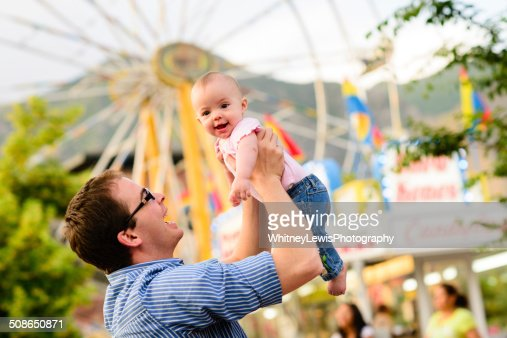 Baby and Dad at the Fair : Stock Photo