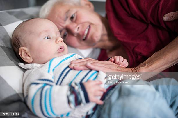 Baby and grandmother in bed