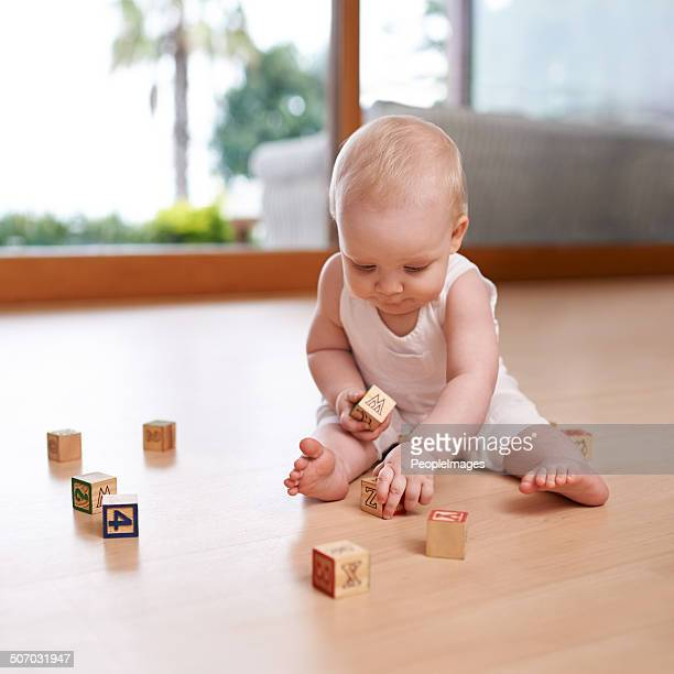 Baby and her blocks