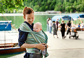Baby and mother on nature. Slovenia, Bled.