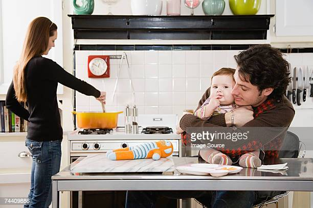 Baby and parents in kitchen