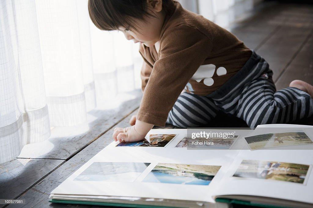 baby and photo album