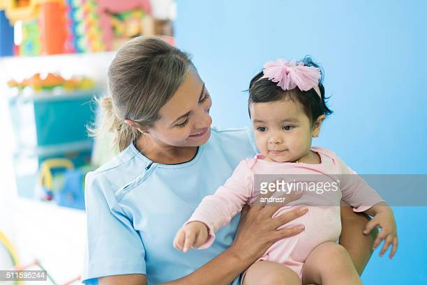 Baby at the hospital in early stimulation therapy
