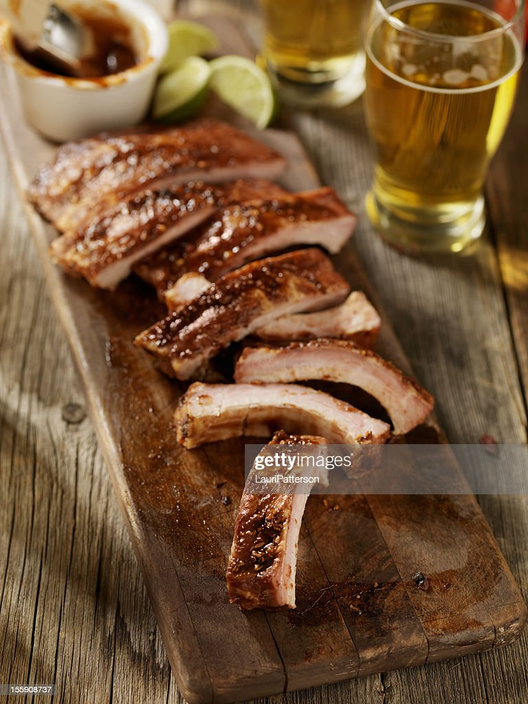Baby Back Pork Ribs with a Couple of Beers : Stock Photo