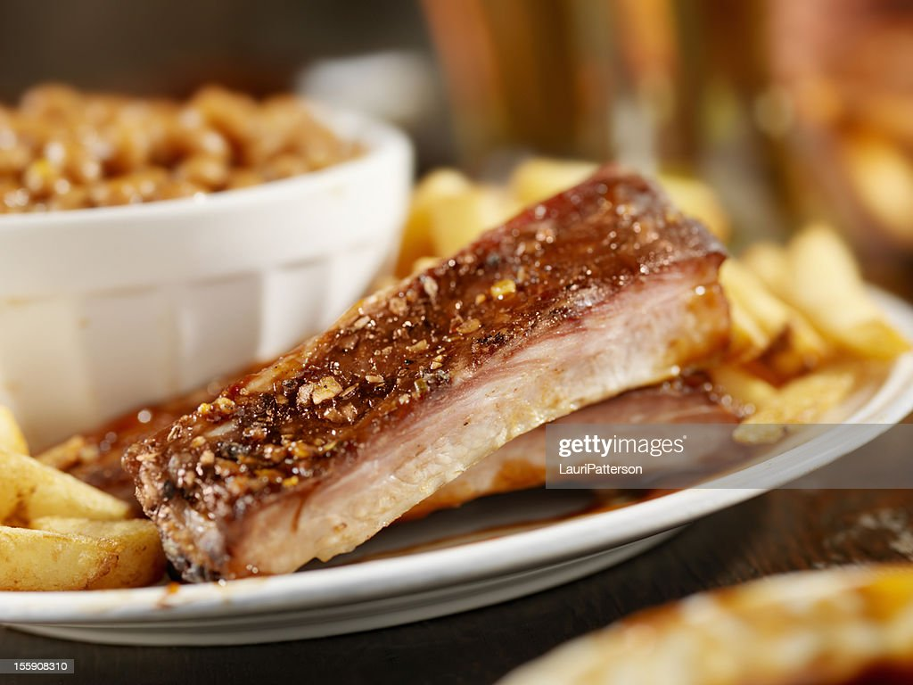 Baby Back Pork Ribs With Baked Beans : Stock Photo