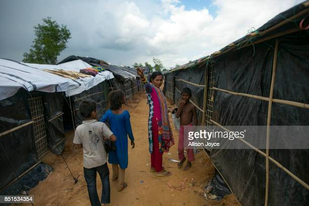 aCOX'S BAZAR BANGLADESH SEPTEMBER 21 Baby Barua goes door to door in Balukhali camp to urge Rohingya refugee children to register and visit a CODEC...