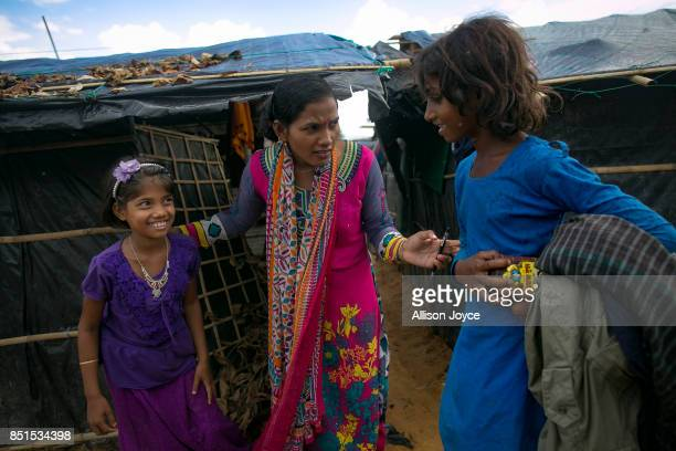 COX'S BAZAR BANGLADESH SEPTEMBER 21 Baby Barua goes door to door in Balukhali camp to urge Rohingya refugee children to register and visit a CODEC...