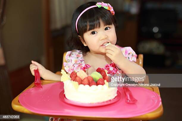 Baby bite a cake