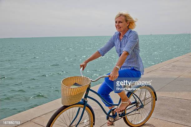 baby boomer woman riding bike