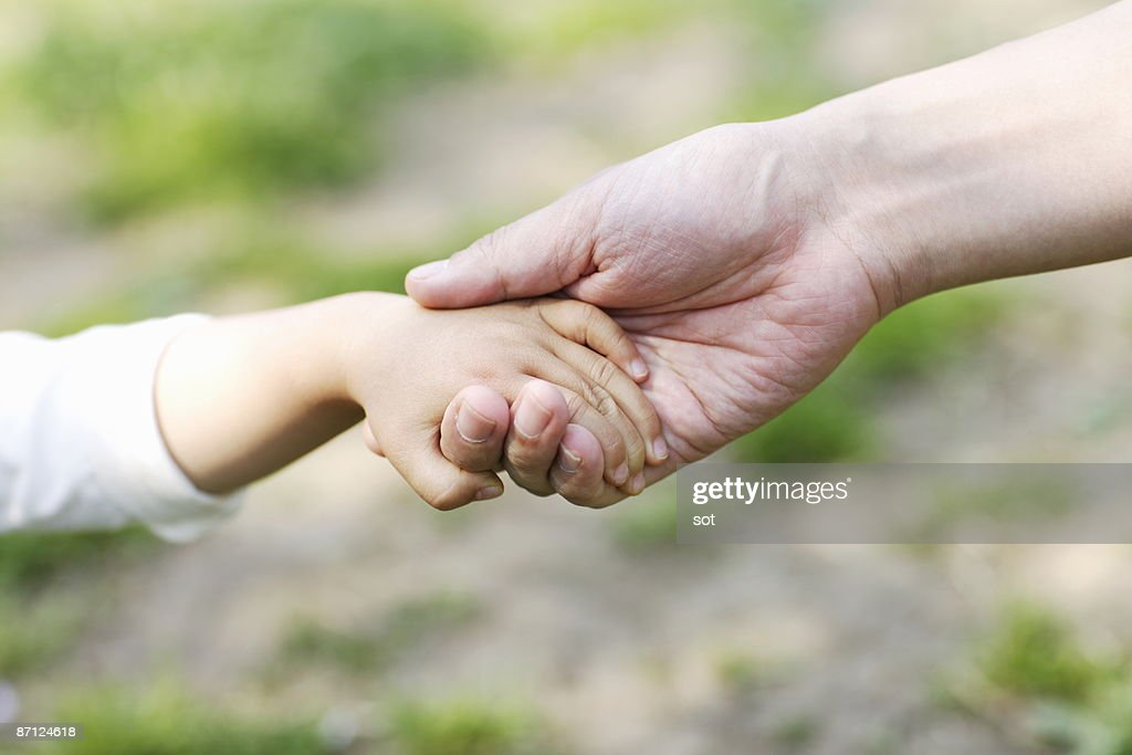 Baby boy and father holding hands,close up : Stock Photo