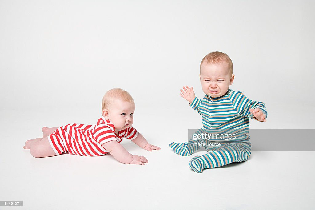 A baby boy and girl : Stock Photo