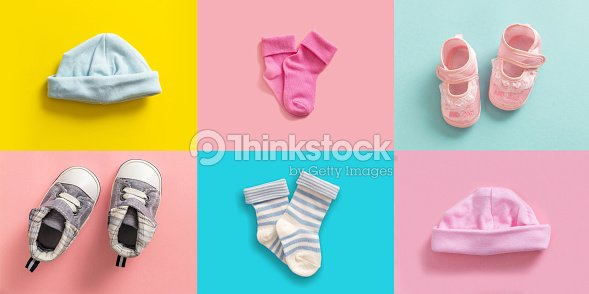 Baby boy and girl shoes and socks collage, pastel colored background : Stock Photo