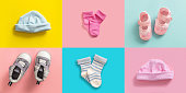 Twins babies shower concept. Baby boy and girl shoes and socks collage, pastel colored background