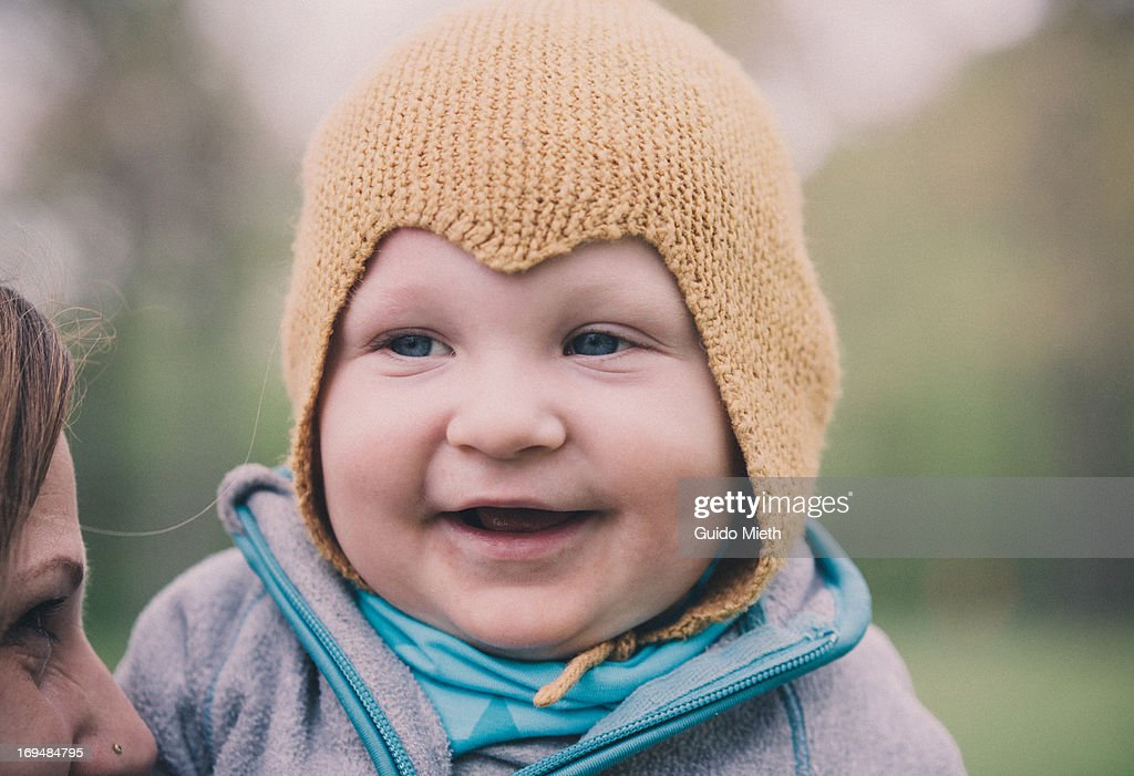 Baby boy and his mother outdoor. : Stock Photo