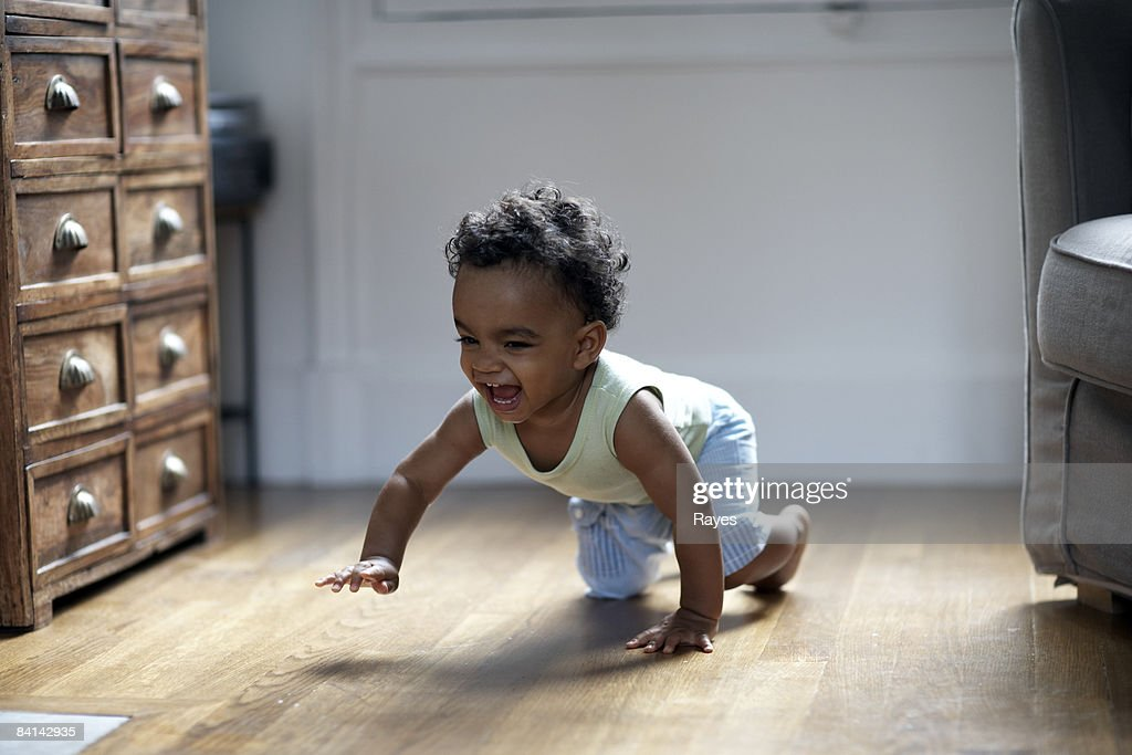 baby boy crawling and smiling