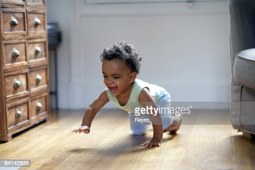 baby boy crawling and smiling : Stock Photo