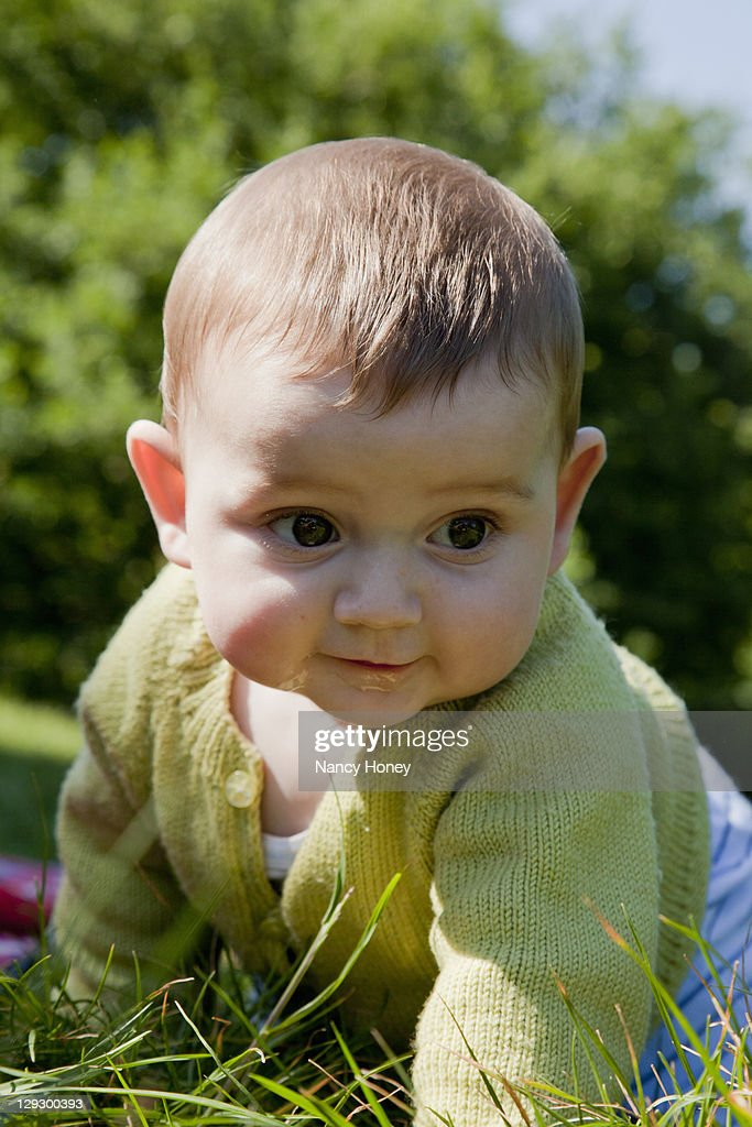 Baby boy crawling in grass : Stock Photo
