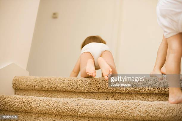 Baby boy crawling up stairs